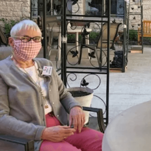 Photo of Lynn Soens wife of an MP resident wearing a face mask