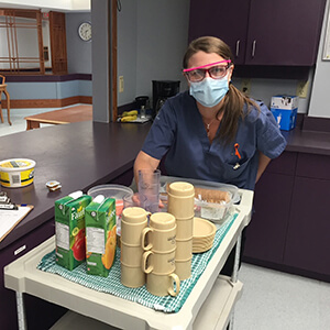 care home support worker prepares a snack
